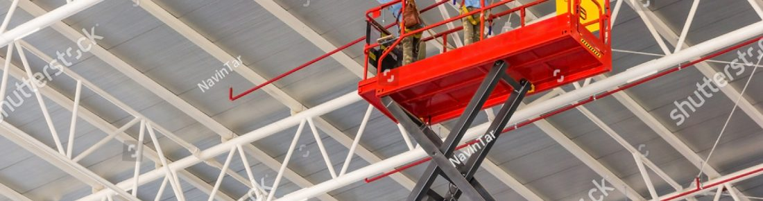 stock-photo-scissor-lift-platform-with-hydraulic-system-elevated-towards-a-factory-roof-with-construction-538637749